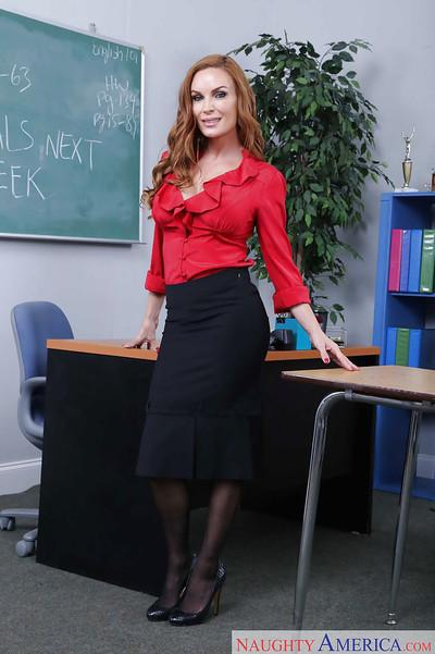 Latina schoolteacher Diamond Foxxx posing in skirt and black stockings