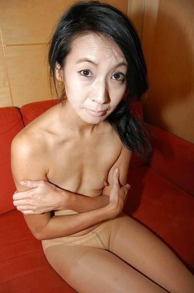 Shy asian MILF uncovering her skinny curves and exposing her gash