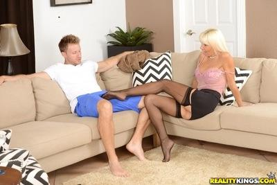 Cougar milf with big tits Kasey Storm is seduced by a younger dude