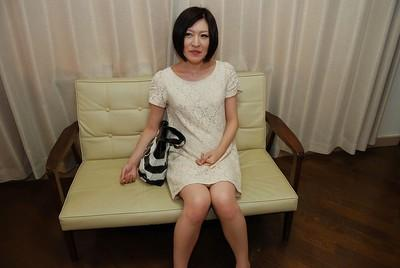 Stunning short-haired model Mari Suzui is masturbating her holes