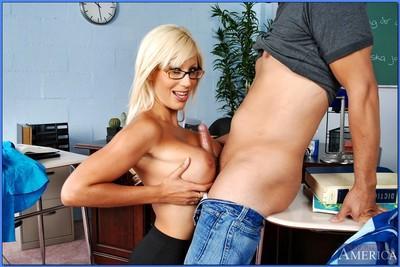 MILF teacher in glasses Puma Swede denudes her booming curves and fucks