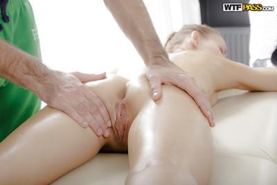 Petite blonde Sabrina has her shaved cunt and tight ass massaged
