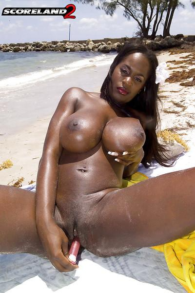 Black mom Nikki Jaye freeing huge juggs from bikini outdoors on beach