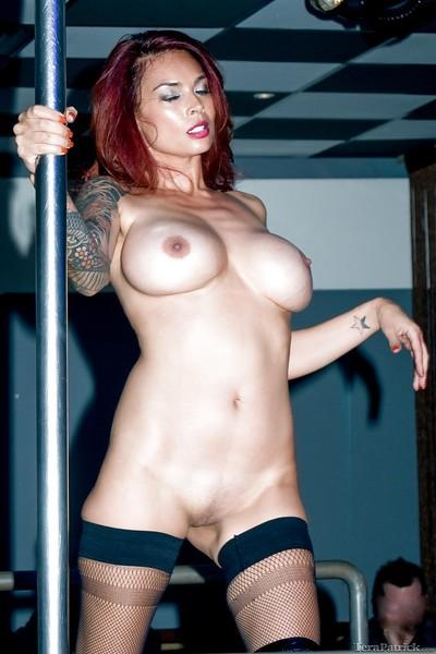Busty Asian MILF Tera Ratrick dancing around stripper pole in boots