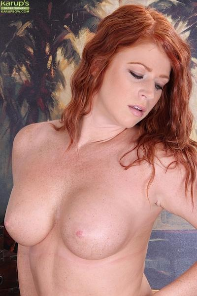 Tempting redhead MILF getting naked and exposing her cunt in close up