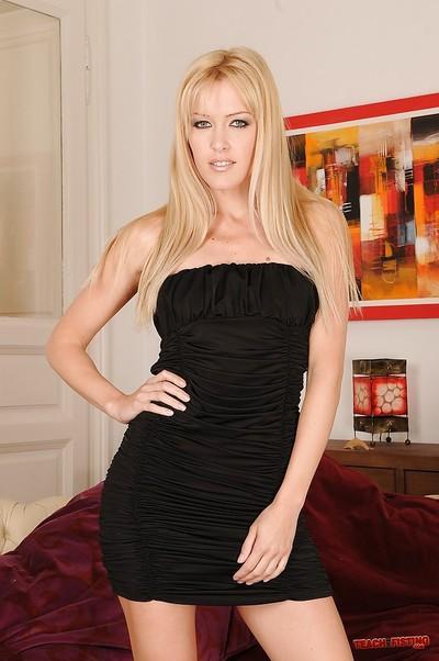 Skinny milf babe with blonde hair Sophie Moone shows her legs in high heels