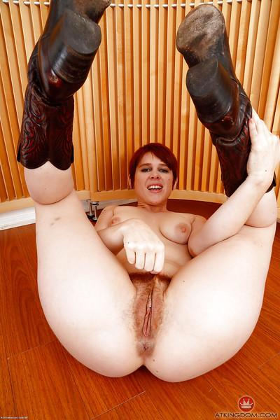 Ginger MILF Lily Cade removes police uniform to expose hairy cunt and ass