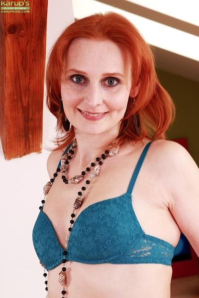 Redheaded mature MILF Bachova modelling solo girl style n bra and panties