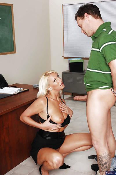 Pretty teacher Emilianna wants to have a young dick in her mouth
