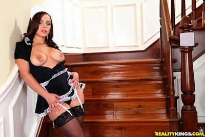 Lustful maid in black stockings exposing her gorgeous ass and tits