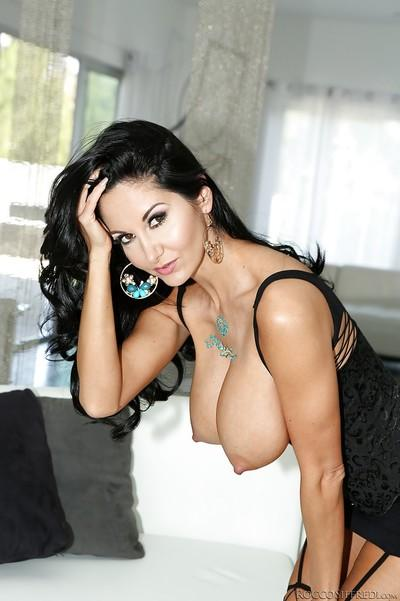 European brunette babe Ava Addams shows off in her stockings