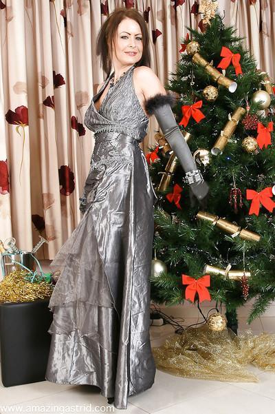 Glamorous MILF in velvet gloves and pantyhose undressing and teasing her slit