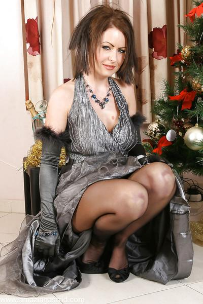 Glamorous MILF in velvet gloves and pantyhose undressing and teasing her slit