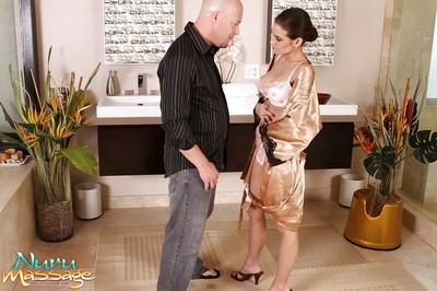 Likable Asian fox Ryder Skye oils long pink cock and sucks it