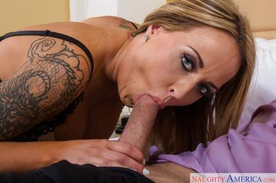 Busty blonde with tattoos jerks and sucks big dick and receives cunnilingus