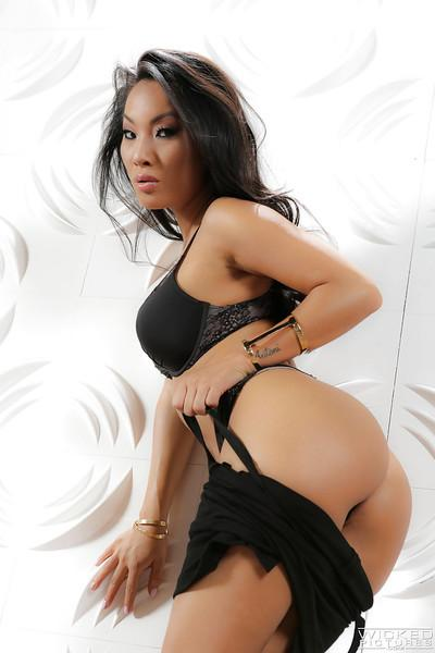 Asian babe Asa Akira removes dress and lingerie to bare MILF pornstar tits