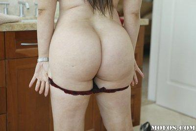 Curvaceous MILF Daphne Rosen slipping on her lacy panties and red dress
