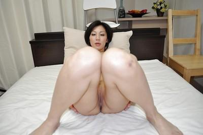 Cuddly asian MILF Mayumi Iihara has some pussy fingering fun after bath