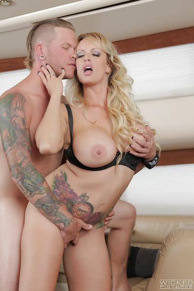 Tattooed pornstar Stormy Daniels riding on top of big dick with tit cumshot