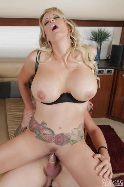Tattooed pornstar Stormy Daniels riding on top of big dick with tit cumshot