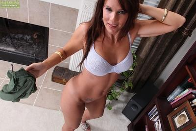 Brunette MILF Dylan Dole strips naked and shows off her hanging mud flaps