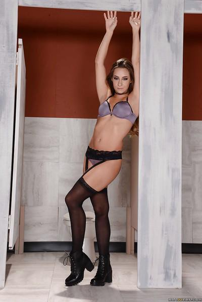 Hot MILF Cassidy Klein posing in pleated schoolgirl skirt and boots