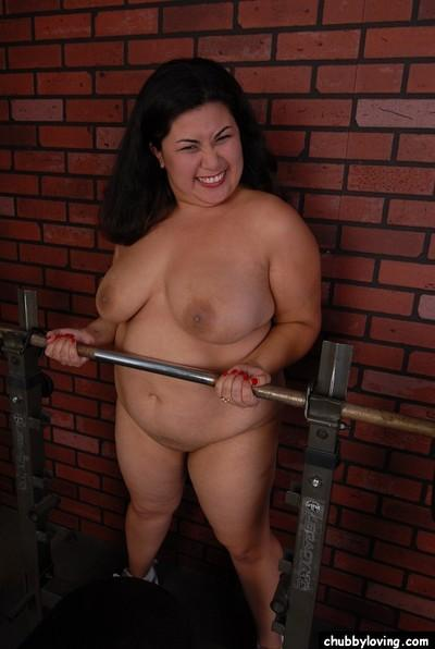 Chubby chick Tyung and her big saggy tits working out in gym