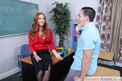 Bosomy MILF teacher Diamond Foxxx slurps a big cock in classroom