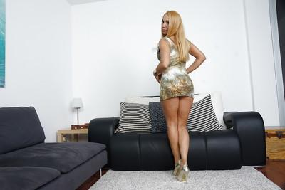 Blonde European mummy Ginger Hell showing off great legs in high heels