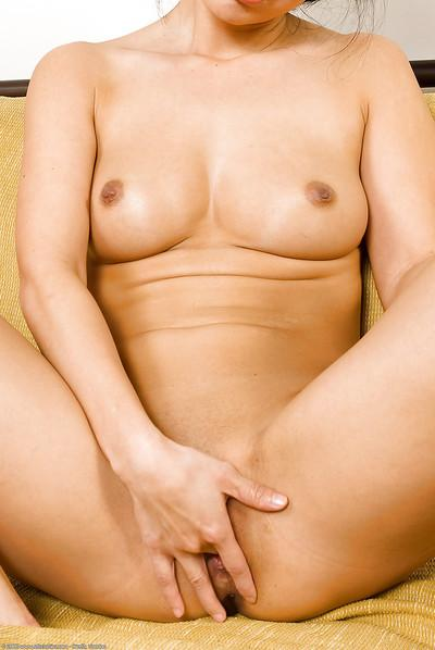 Petite Oriental model Niya Yu lets nice all natural tits free from bikini