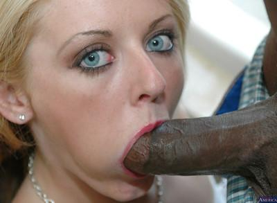 European model Sophie Dee is sucking this giant black shaft!