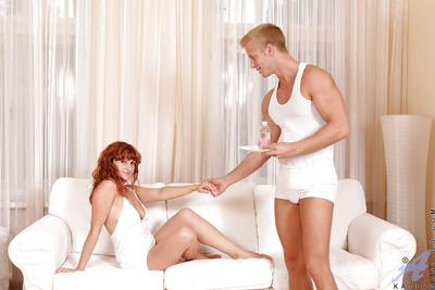 Fascinating redhead cougar Katia is jumping on a thick beaver-cleaver