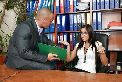 Voluptuous secretary in glasses has partly clothed sex with her horny boss