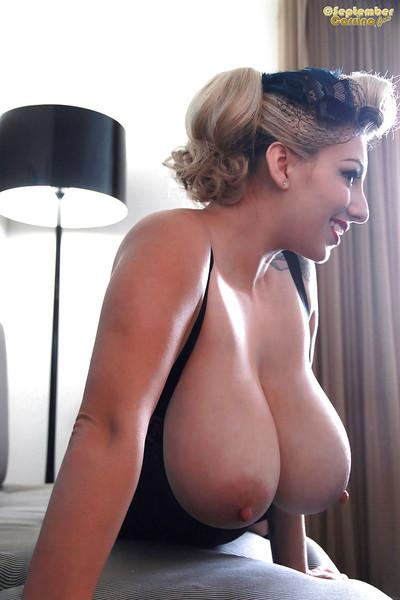 Milf September Carrino shows her big natural boobies in close-up