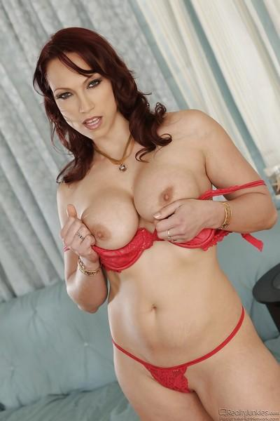 Nicki Hunter reveals her milf big tits while undressing her lingerie