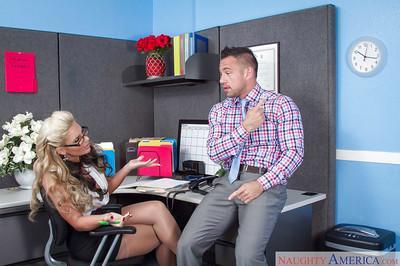 Curvy blonde pornstar Phoenix Marie deepthroats cock and takes creampie