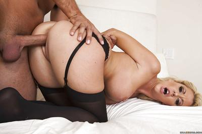 Voluptuous blonde Courtney Taylor gives a titjob and gets nailed