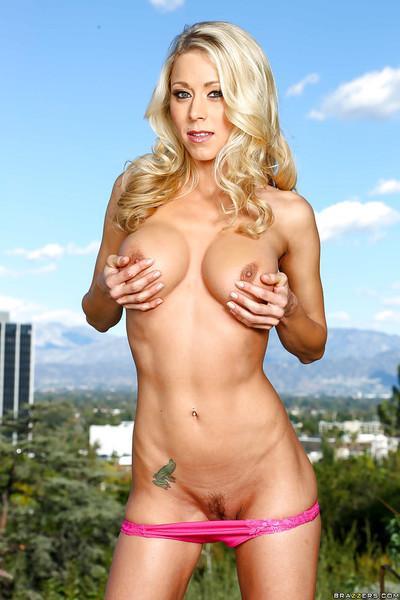 Busty blonde MILF Katie Morgan posing outdoors for nude photos