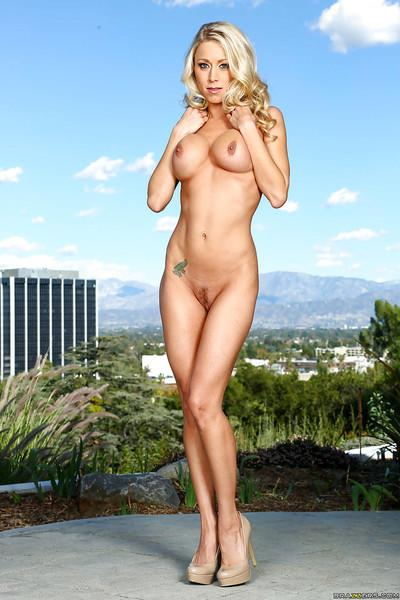 Busty blonde MILF Katie Morgan posing outdoors for nude photos