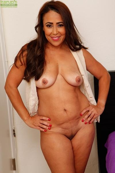 Fat brunette MILF Gabriella Santorini bares saggy tits before masturbation