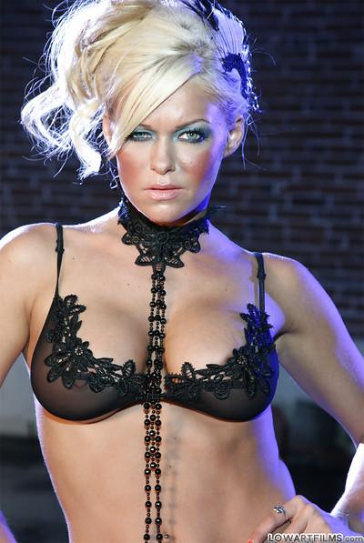 Lusty blonde MILF in lacy lingerie Krista Moore uncovering her tits and pussy