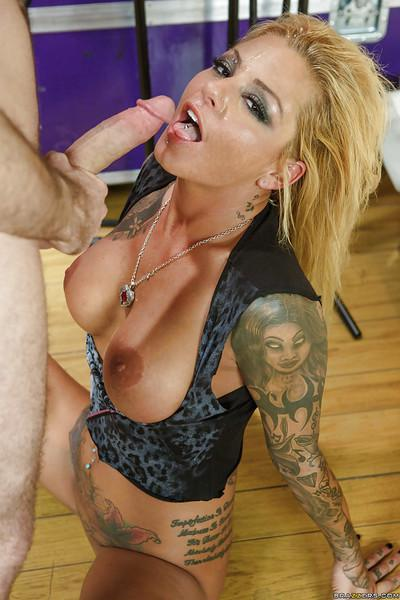 Busty tattooed MILF gets anally fucked and takes cum on her face