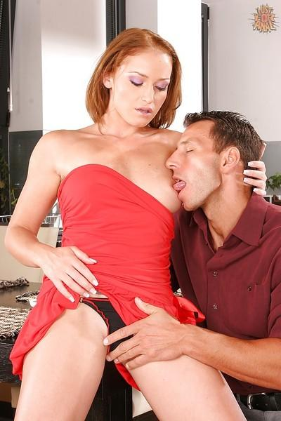 Redheaded European MILF Kathia Nobili parking pussy on top of large penis