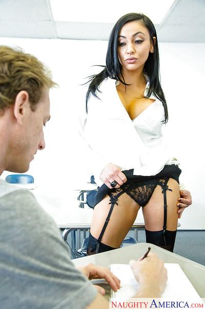 Buxom sex teacher in stockings Audrey Bitoni shows a student how to fuck