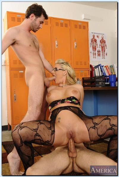 Gorgeous teacher in glasses Phoenix Marie gets banged by her horny students