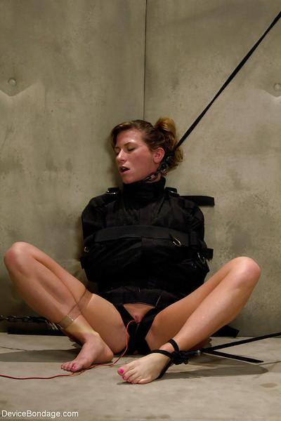A straight jacket restrained Ariel X receives electroshock on bald pussy