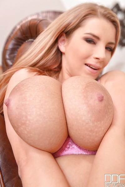 Chesty MILF Katerina Hartlova exposing huge knocker and licking own nipples