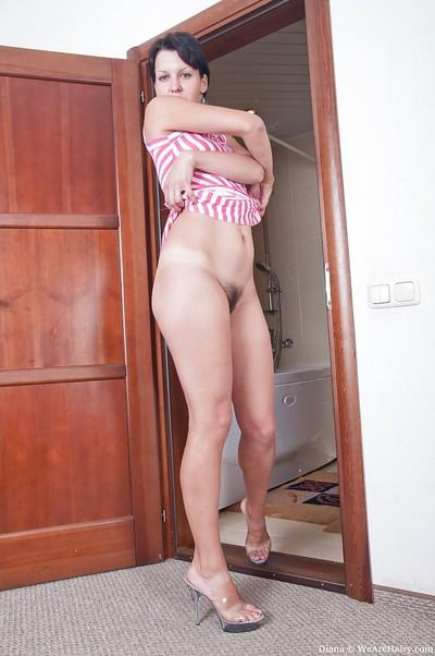 Brunette MILF with tiny tits stripping and taking a shower