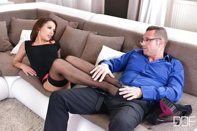 Hot Italian babe Nikita Bellucci jerking cock with nylon adorned feet