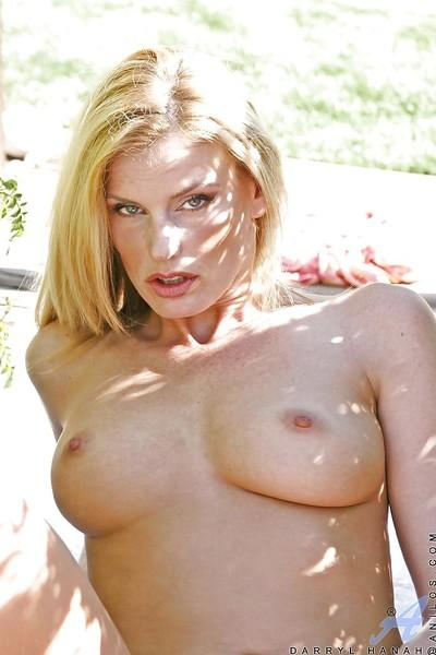 Sexy MILF blonde with big tits takes her clothes off outdoor.